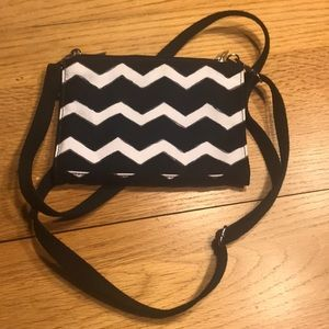 Thirty-one small cross-body